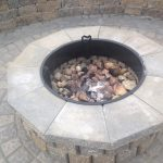 Above and Beyond fire pit patio with seating Omaha