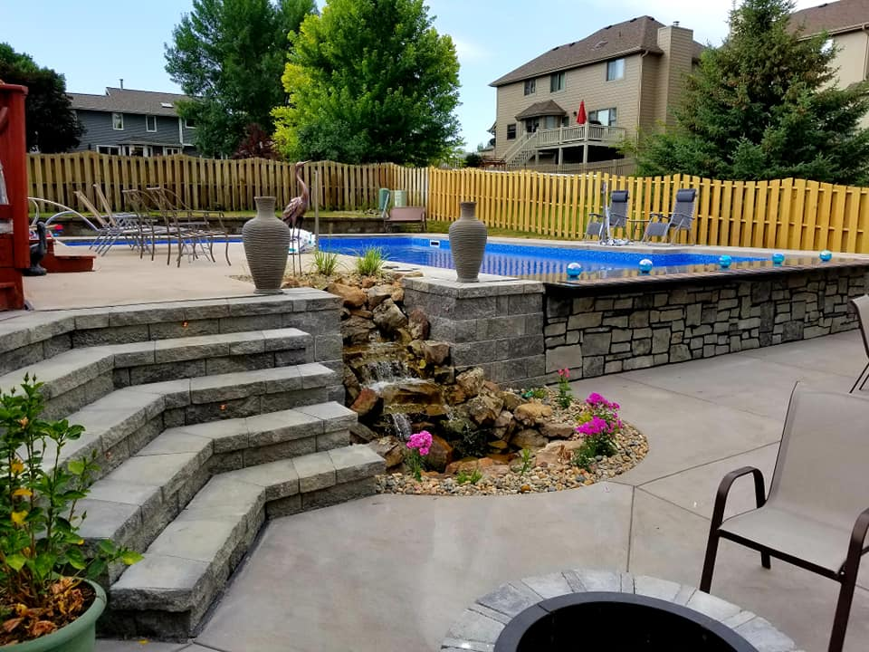 Back-yard-landscape-redo-water-feature-fire-pit-swimming-pool-retaining-wall-stairs