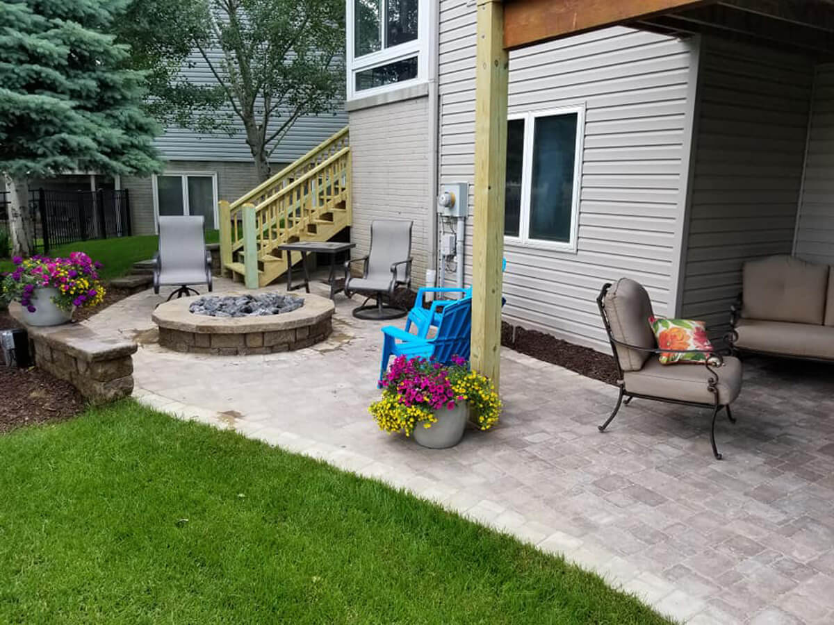 Back-yard-paver-patio-fire-pit-Omaha-Landscaping-Above-and-Beyond-CGM