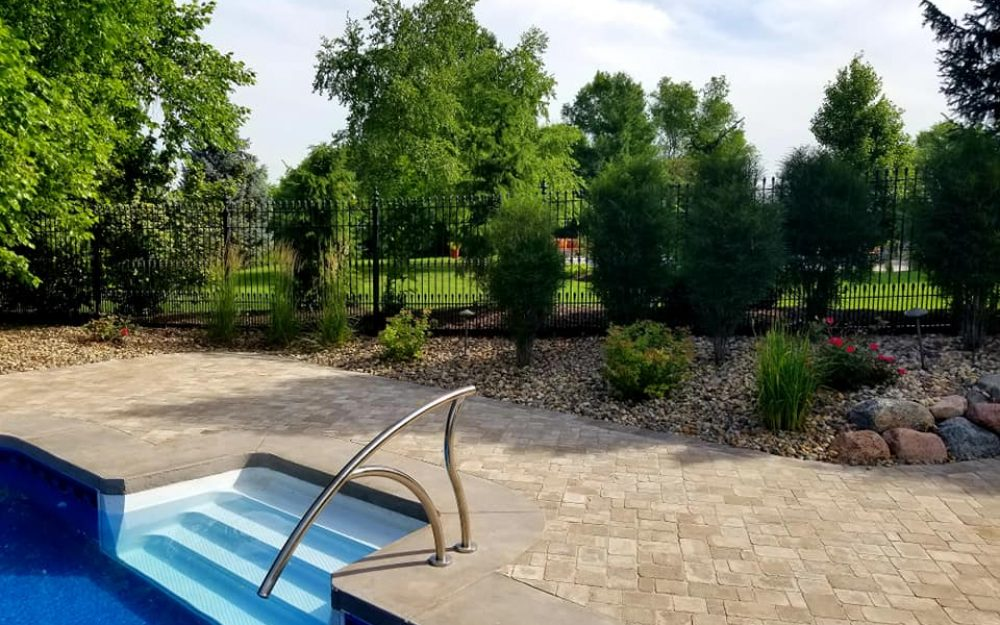 Back-yard-swimming-pool-landscape-in-Omaha